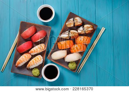 Delicious Appetizing Nigiri Sushi Set, Served On Clay Plates With Soy Sauce And Chopsticks, Flat Lay