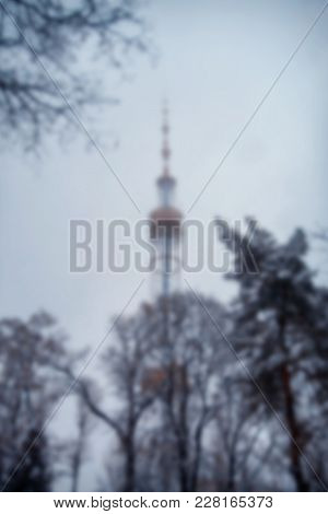 Kyiv Television Tower In Winter Haze, Blurred Background
