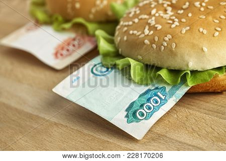 Burgers With One Thousand And Five Thousand Rubles Bills. Business Concept