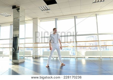 Male Person Making Swipe And Vigorous Movements In White Shirt And Pants. Blonde Dancer Training At