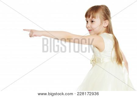 Little Girl Pointing At Something. The Concept Of Family Happiness And The Development Of The Child.