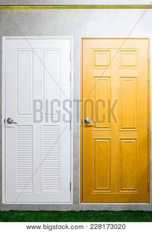 Interior Of A Room With Wooden And White Doors