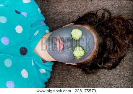 Spa Woman Applying Facial Cleansing Mask. Beauty Treatments Mask On The Face Of A Young Girl