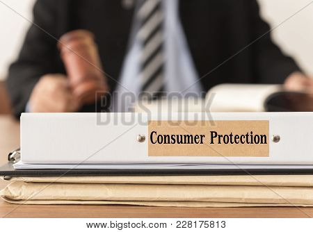 Consumer Protection Lawsuit Documents With Lawyer Work At Law Firm. Concept Of Consumer Protection L