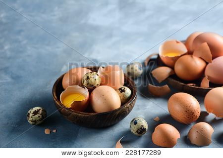 Cooking With Raw Eggs Background. Quail And Brown Chicken Eggs On A Wooden Dish. Modern Easter Conce