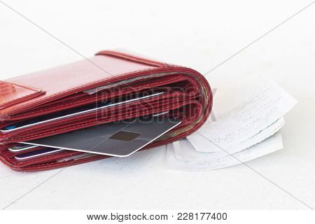 Money With Credit Card In Red Purse And Slips Expense For Check On Table White