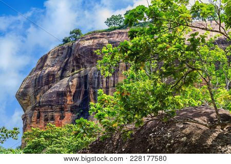 View On Top The Sigiriya Lion Rock Against The Sky With Clouds. Sri Lanka