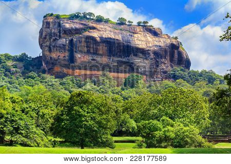 Fortress Of Sigiriya Lion Rock Against The Sky With Clouds. Sri Lanka