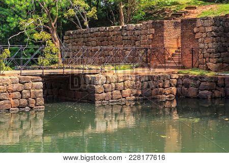 Ancient Stone Bridge Across A Canal On The Road To The Fortress Of Sigiriya Lion Rock. Sri Lanka