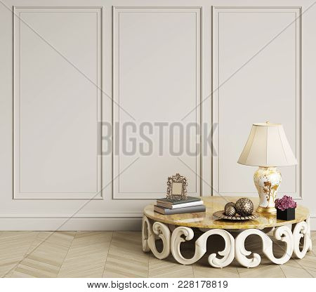 Classic Art Deco Table  With Lamp,orchid And Books  Is Standing In Empty Classic Interior.walls With