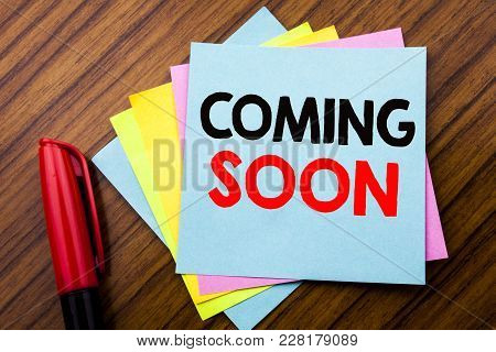 Handwriting Announcement Text Coming Soon.  Concept For Under Construction Written On Sticky Stick N