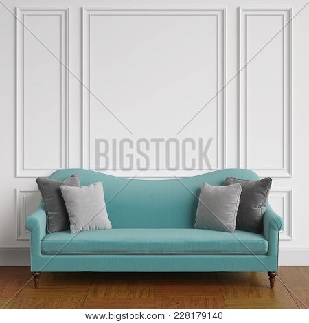 Classic Blue Sofa With Grey Pillows   Standing In Classic Interior.white Walls With Mouldings,floor