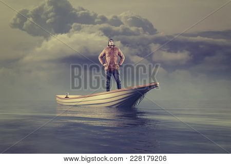 Young Man In A Boat At Sea Looking Up To The Horizon.