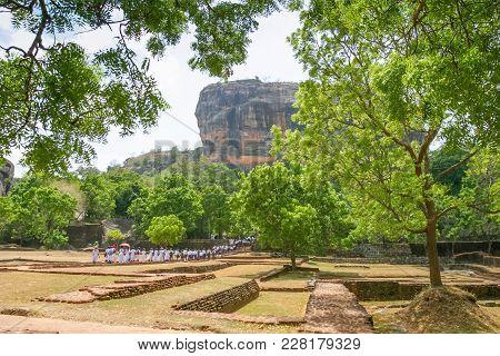 Sigiriya Rock, Sri Lanka - September 6, 2003: School Children Exploring The Garden At The Foot Of Th