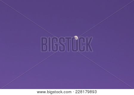 Ultra Violet Background - The Half Moon On The Purple Cloudless Sky. Toned, Space For Copy.