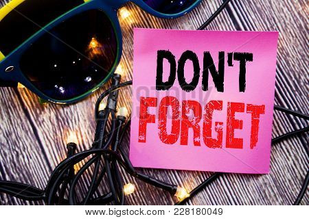 Hand Writing Text Caption Showing Do Not Forget. Business Concept For Don T Memory Remider Written O