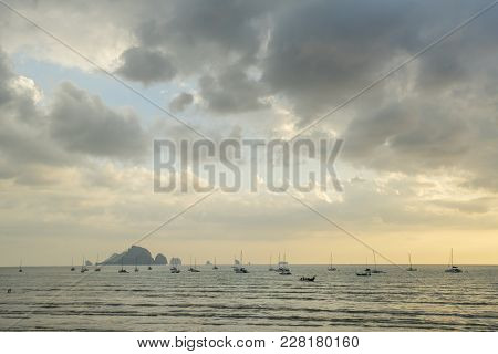 A Lot Of Long Tail Boat Back From Diving At The Ao Nang Beach Before The Sunset In Krabi Thailand
