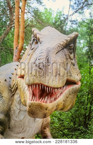 Belgorod, Russia - July 04, 2017: Tyrannosaur Head - Robotic Dinosaur Exhibit. Portrait Of A Sharp-t