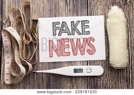 Handwritten Text Showing Fake News. Business Fitness Health Concept Writing For Hoax Journalism Writ
