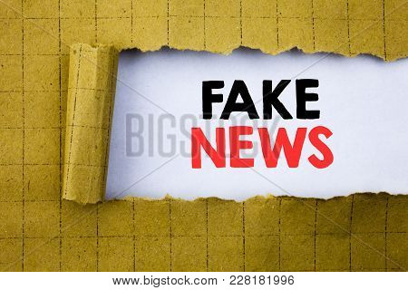 Fake News. Business Concept For Hoax Journalism Written On White Paper On Yellow Folded Paper.