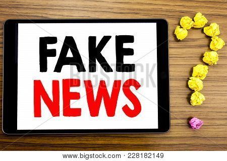 Writing Text Showing Fake News. Business Concept For Hoax Journalism Written On Tablet Computer On W