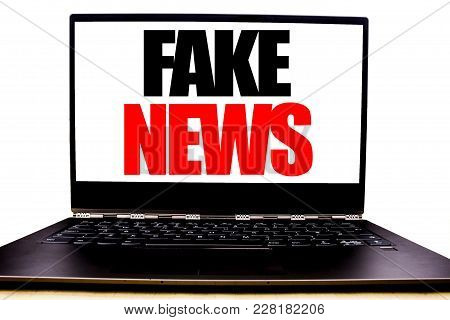 Handwritten Text Showing Fake News. Business Concept Writing For Hoax Journalism Written On Monitor