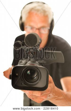 Professional video camera man with focus on objective poster