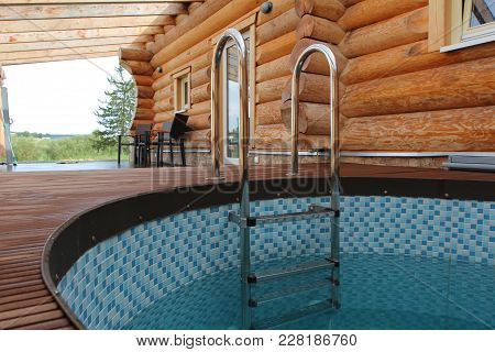 Sauna Is Healthy / A Small Pool For Cooling Off After The Sauna