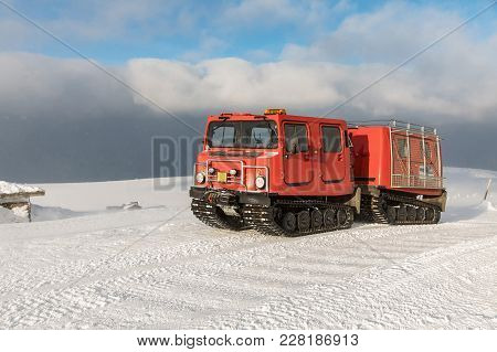 Red Ratrak Snowcat In Winter Mountains A Red Snow Tucker Covered With Snow In Krkonose Mountain. Red