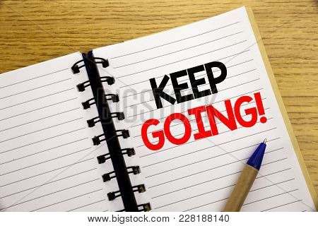 Word, Writing Keep Going. Business Concept For Go Moving Forward Letting Written On Notepad With Spa