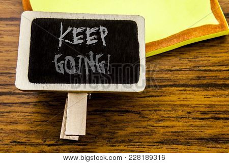 Handwritten Text Showing Keep Going. Business Concept For Go Moving Forward Letting Written On Annou