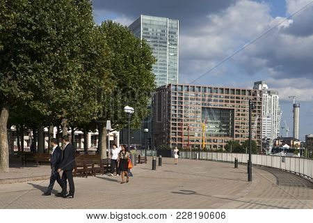 London, England - July 12, 2017canary Wharf Middle Dock And Docklands Light Railway