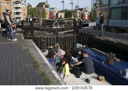 Young People Sitting Along The Banks Of The Regent's Canal At Hackney, East London, England, Uk