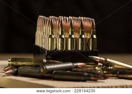 .223 Caliber Cartridges Standing In Their Packaging With An Array Of Military Surplus Ar-15 Ammuniti