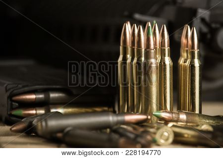 Arrangement Of .223 Caliber Ammunition Including Loose Bullets, And Loaded Magazines From An Ar-15 S