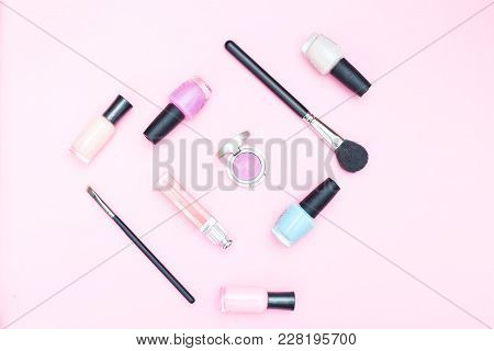 Female Beauty Makeup On Pink Background. Flat Lay