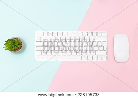 Keyboard And Mouse On Two Tone Pastel Background. Flat Lay