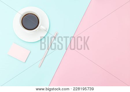 A Cup Of Coffee And Stationery  On Pastel Color Background. Flat Lay