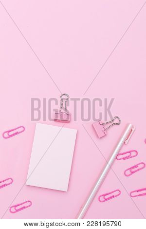 Stationery Items Of Pink Color On A Pink Background. Vertical Flat Lay