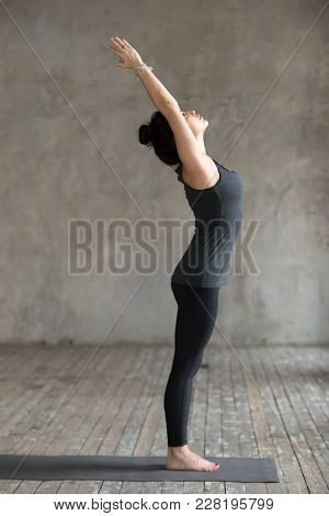 Young Woman Practicing Yoga, Doing Mountain Exercise, Tadasana Pose, Working Out, Wearing Sportswear