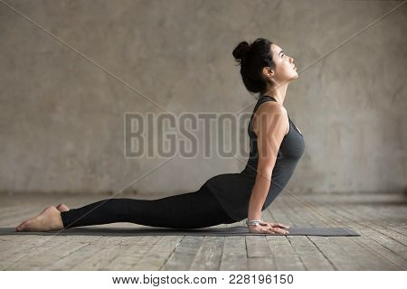 Young Woman Practicing Yoga, Doing Upward Facing Dog Exercise, Urdhva Mukha Shvanasana Pose, Working