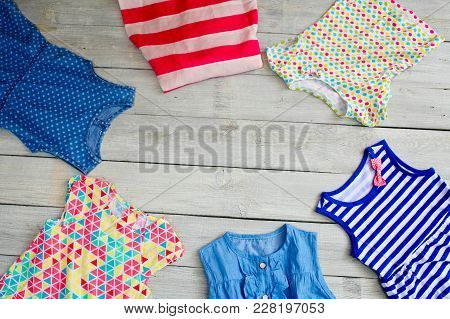 Beautiful Kidswear For The Girl On A White Wooden Background