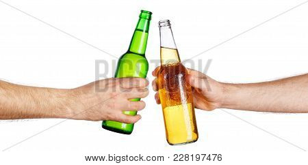 Male Hands With Cold Beer Bottles, Isolated On White Background. Beer Up. Cheers. Pair Of Beer Bottl