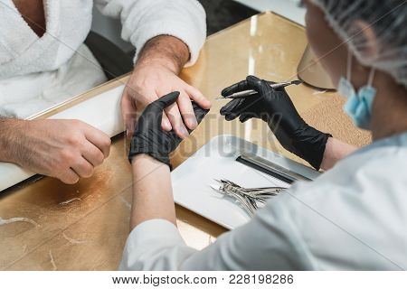 The Manicure Master During Treatmet Procedure. Patient On Medical Pedicure Procedure, Visiting Podia