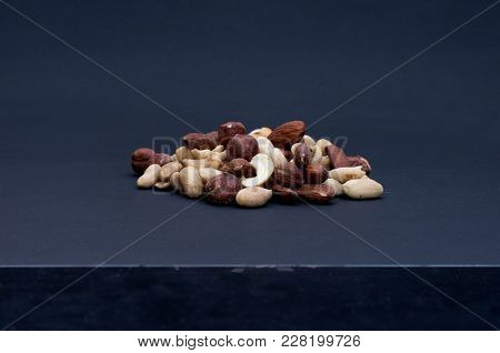 A Set Of Various Nuts. A Bunch Of Nuts On A Black Background. Isolate Nuts On A Black Background.