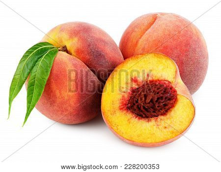 Group Of Peaches With Half And Green Leaves Isolated On White Background With Clipping Path