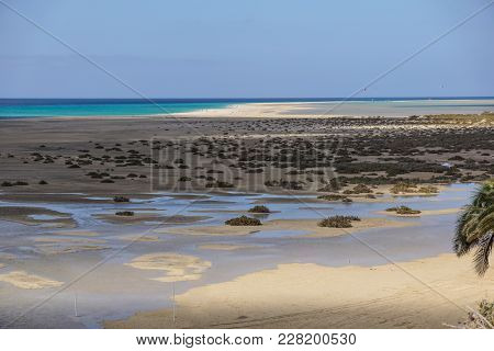 Mud Flats At Low Tide Off The Coast Of Canary Island .