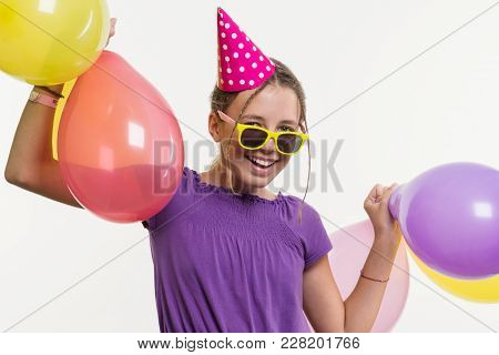 Cheerful Teenager Girl 12, 13 Years Old, With Balloons On White Background.