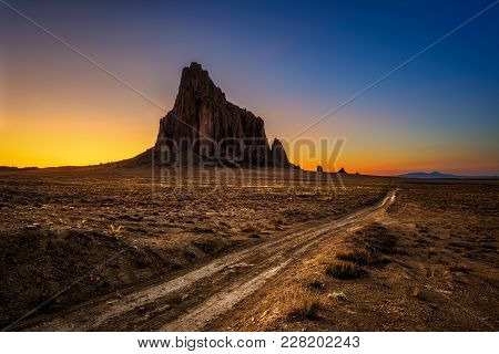 Sunset Above Shiprock. Shiprock Is A Great Volcanic Rock Mountain Rising High Above The High-desert
