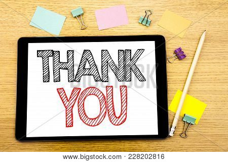 Writing Text Showing Thank You. Business Concept For Gratitude Thanks Written On Tablet, Wooden Back